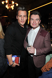 Left to right, Skater MATT EVERS and radio presenter GREG BURNS at the opening night performance of The Rocky Horror Show, This performance is to celebrate the 40th Anniversary UK Tour, at The New Wimbledon Theatre, Wimbledon, London SW19 on 21st January 2013.