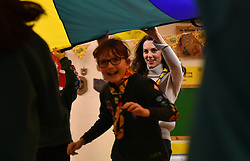 The Duchess of Cambridge takes part in a parachute game during a Cub Scout Pack meeting with cubs from the Kings Lynn District, in Kings Lynn at the The Scout and Guide Hut in North Wootton, near King's Lynn, for an event to celebrate 00 years of the Cub Scout movement.