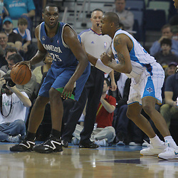 08 February 2009:  Minnesota Timberwolves center Al Jefferson (25) is defended by New Orleans Hornets forward David West (30) during a NBA game between the Minnesota Timberwolves and the New Orleans Hornets at the New Orleans Arena in New Orleans, LA.