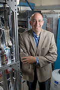 Dr. David Bayless stands next to a super critical water reactor in the Ohio Coal Research Center at Ohio University. The reactor is used to remediate waste water from hydraulic fracturing. Dr. Bayless's son wrote the line view code for the control panel as a senior in high school.