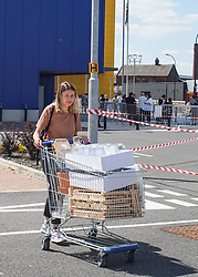 © Licensed to London News Pictures. 01/06/2020. Sheffield , UK. A woman pushes a trolley as she carrying away her shopping  at the IKEA furniture store in  Sheffield , South Yorkshire. The furniture and housewares chain reopened some of their stores across England and Northern Ireland  since the lockdown began.  Photo credit: Ioannis Alexopoulos/LNP