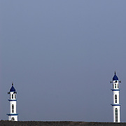 Oman, Sinaw. March/09/2008. ..Mosque minarets jut out of the horizon in Sinaw.