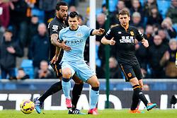 Manchester City's Sergio Aguero is closed down by Hull City's Tom Huddlestone - Photo mandatory by-line: Matt McNulty/JMP - Mobile: 07966 386802 - 07/02/2015 - SPORT - Football - Manchester - Etihad Stadium - Manchester City v Hull City - Barclays Premier League