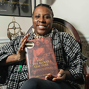 Former UD professor Arica Coleman pose for a photo with a copy of her book &quot;That the Blood Stay Pure: African Americans, Native Americans&quot; at her home Wednesday. Feb. 27, 2019, in Newark, DE. <br /> <br /> Former UD professor was denied tenure. She believes it was discriminatory