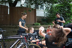 Heather Fischer (USA) of Rally Cycling Team braids her team mate's, Emma White's (USA) hair before the Philadelphia International Cycling Classic, a 117.8 km road race in Philadelphia on June 5, 2016 in Philadelphia, PA.