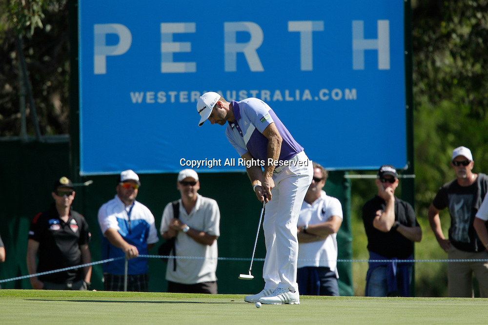 18.10.2013 Perth, Australia. Dustin Johnson (USA) Putts on the 13th green during day 2 of the ISPS Handa Perth International Golf Championship from the Lake Karrinyup Country Club.