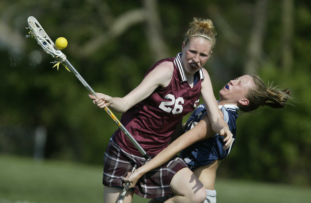 (SPORTS) Howell 4/19/2002  Toms River South's # 26 Mary Wood tries to control the ball as she collides with Howell's # 16  ________   Hennesy ( sorry again no first names.)   Michael J. Treola Staff Photographer........MJT