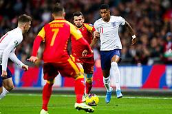 Marcus Rashford of England is challenged by Boris Kopitovic of Montenegro - Rogan/JMP - 14/11/2019 - FOOTBALL - Wembley Stadium - London, England - England v Montenegro - UEFA Euro 2020 Qualifiers.