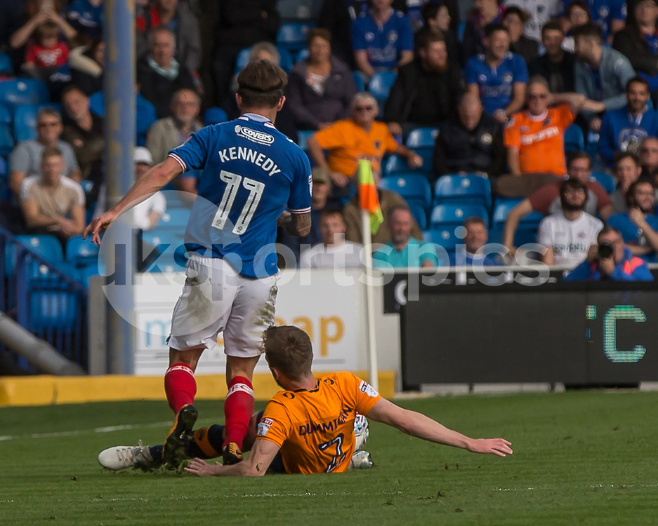 Cameron Dummigan of Oldham Athletic fouls Matthew Kennedy of Portsmouth during the EFL Sky Bet League 1 match between Portsmouth and Oldham Athletic at Fratton Park, Portsmouth, England on 30 September 2017. Photo by Simon Carlton.