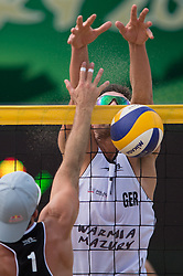 04.07.2013, Lake Szelag, Stare Jablonki, POL, FIVB Beach Volleyball Weltmeisterschaft, im Bild Angriff Todd Rogers (USA) - Block Jonathan Erdmann (#1 GER), // during the FIVB Beach Volleyball World Championships at the Lake Szelag, Stare Jablonki, Poland on 2013/07/04. EXPA Pictures © 2013, PhotoCredit: EXPA/ Eibner/ Kurth ***** ATTENTION - OUT OF GER *****