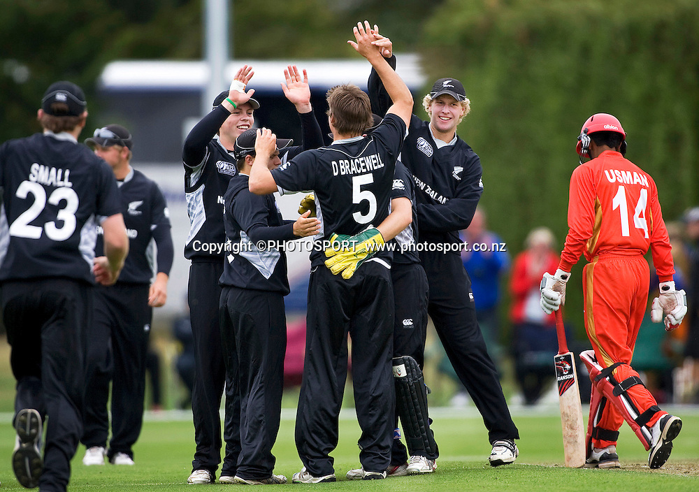 New Zealand's Douglas Bracewell is congratulated by his team mates after bowling Usman Limbada. New Zealand v Canada, U19 Cricket World Cup group stage match, Lincoln #3, Saturday 16 January 2010. Photo : Joseph Johnson/PHOTOSPORT