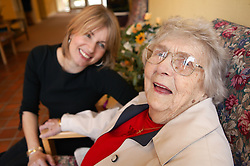 Elderly woman and carer in sheltered accommodation,