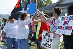 Mary Hargis with the Rowan County Rights Coalition, center and Lisa Williams walk the line of demonstrators during a rally outside the Rowan County Courthouse in protest of Kim Davis' boycott on issuing marriage licenses, Saturday, Aug. 29, 2015 in Morehead. Photo by Jonathan Palmer/Special for the C-J