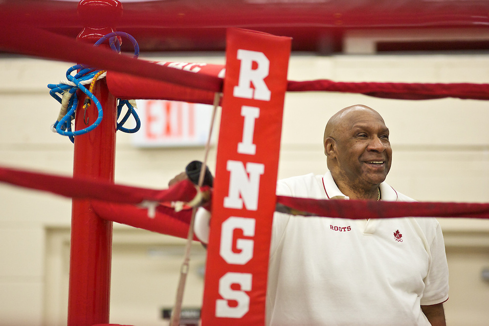 Windsor, Ontario ---10-05-06--- Boxing coach Charlie Stewart looks on as World Welterweight Champion, Mary Spencer spars during a training session at the Windsor Amateur Boxing Club in Windsor, Ontario, May 6, 2010.<br /> GEOFF ROBINS The Globe and Mail