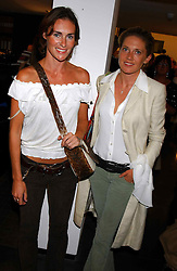 Left to right, LAETITIA CASH and ZOE LEY at a party to celebrate the opening of an exhibition of photographs by the late Norman Parkinson held at Hamiltons gallery, 13 Carlos Place, London W1 on 14th September 2004.<br /><br />NON EXCLUSIVE - WORLD RIGHTS