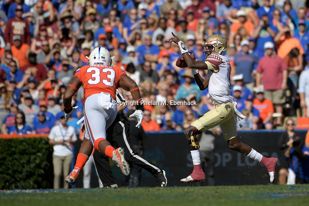 Florida State quarterback James Blackman (1) throws a pass in front of Florida linebacker David Reese (33) during the first half of an NCAA college football game Saturday, Nov. 25, 2017, in Gainesville, Fla. (Photo by Phelan M. Ebenhack)