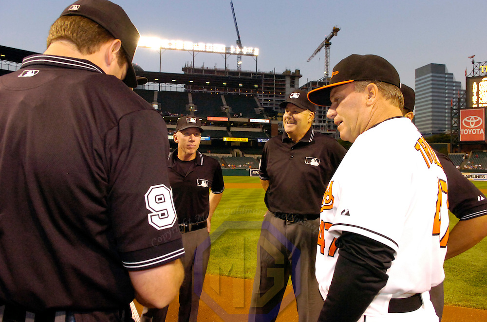 25 September 2007:  Umpire Lance Barksdale (L) and Gary Cedestrom (C) stand at home plate at the start of the game between the Toronto Blue Jays and the Baltimore Orioles.  The Blue Jays defeated the Orioles 11-4 at Camden Yards in Baltimore, MD.  ****For Editorial Use Only****