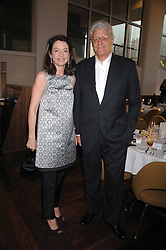 DR & MRS GERT-RUDOLPH FLICK at a dinner hosted by Vogue in honour of Antony Gormley held at the new Skylon restaurant at the refurbished Royal Festival Hall, South Bank, London on 22nd May 2007.<br />