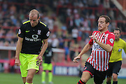 midfielder Luke Summerfield gets past midfielder Ryan Harley during the Sky Bet League 2 match between Exeter City and York City at St James' Park, Exeter, England on 22 August 2015. Photo by Simon Davies.
