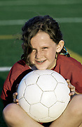 Portrait of girl with soccer ball.