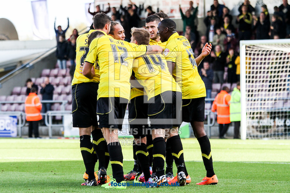 Burton players celebrate after a goal from Alex MacDonald of Burton Albion (not shown) during the Sky Bet League 2 match at Sixfields Stadium, Northampton<br /> Picture by Andy Kearns/Focus Images Ltd 0781 864 4264<br /> 11/10/2014