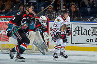 KELOWNA, CANADA - OCTOBER 20: Kelvin Hair #3 of the Kelowna Rockets checks Ilijah Colina #23 of the Portland Winterhawks on October 20, 2017 at Prospera Place in Kelowna, British Columbia, Canada.  (Photo by Marissa Baecker/Shoot the Breeze)  *** Local Caption ***