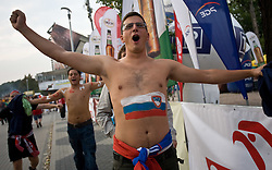 Slovenian fans with  the flag on the skin outside the arena at the EuroBasket 2009, on September 16, 2009, before Arena Lodz, Hala Sportowa, Lodz, Poland.  (Photo by Vid Ponikvar / Sportida)