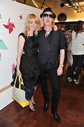 EDITH BOWMAN and JAMES BROWN at a party to celebrate the launch of the Lucy in Disguise Ready to Wear collection exclusive to Harvey Nichols, held at The Fifth Floor Restaurant, Harvey Nichols, Knightsbridge, London on 25th May 2011.