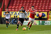Port Vale midfielder Paulo Tavares (8) runs towards the penalty area, under pressure from Charlton Athletic midfielder Andrew Crofts (8) during the EFL Sky Bet League 1 match between Charlton Athletic and Port Vale at The Valley, London, England on 19 November 2016. Photo by David Charbit.