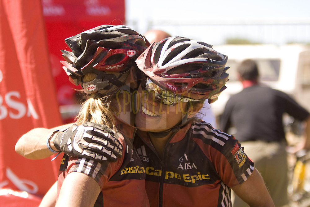 WESTERN CAPE, SOUTH AFRICA -  31 March 2008, Women winners Susan Haywood and Jennifer Smith hug each other at the finish during stage three of the 2008 Absa Cape Epic Mountain Bike stage race from Calitzdorp Spa.to Langenhoven High School in Riversdale, Western Cape, South Africa..Photo by Karin Schermbrucker/SPORTZPICS
