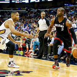 Oct 23, 2013; New Orleans, LA, USA; Miami Heat shooting guard Dwyane Wade (3) is guarded by New Orleans Pelicans shooting guard Eric Gordon (10) during the second half of a preseason game at New Orleans Arena. The Heat defeated the Pelicans 108-95. Mandatory Credit: Derick E. Hingle-USA TODAY Sports