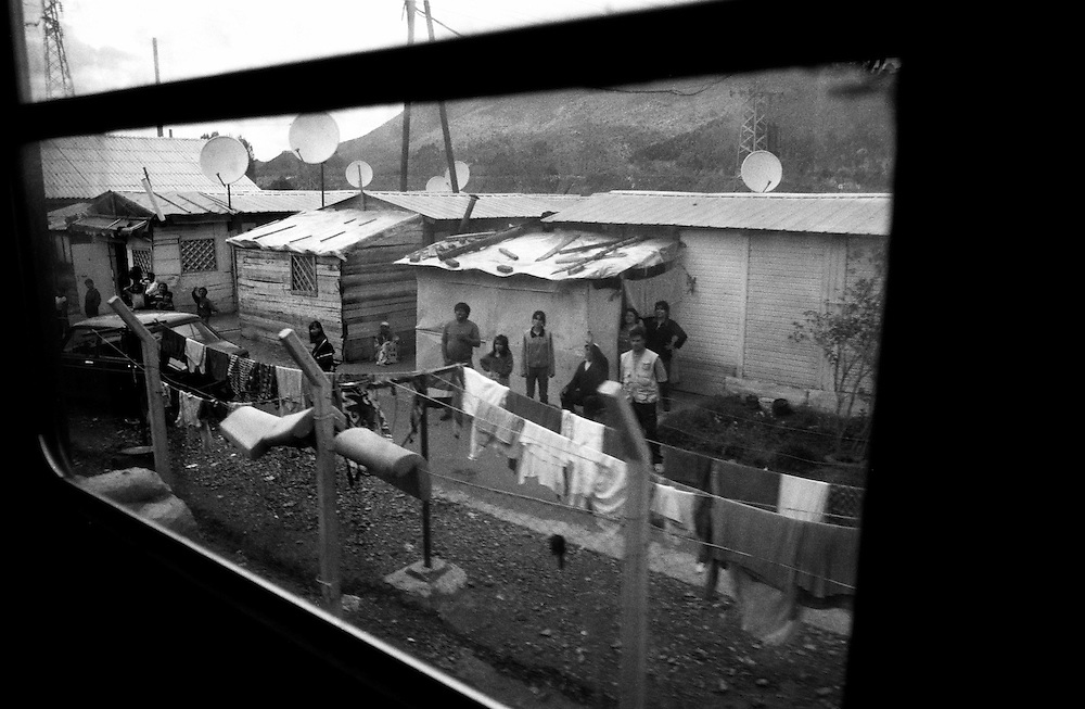The railway camp - In Mitrovica the divided town, some 200 of the 10.000 people who used to live in the gypsy area on the south side, now live in a camp on the north side. The camp is next to the railway, and four times a day the Kfor train passes by. ..Mitrovica railway camp.