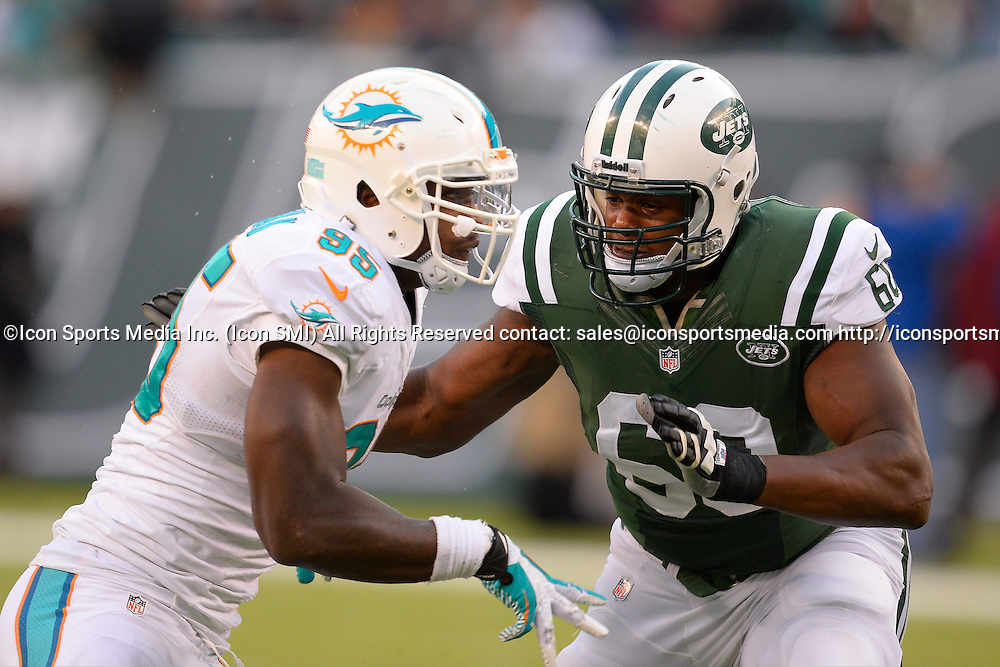 December 1, 2013: New York Jets tackle D'Brickashaw Ferguson (60) blocks Miami Dolphins defensive end Dion Jordan (95) during the second half of a NFL AFC East matchup between the Miami Dolphins and the New York Jets at MetLife Stadium in East Rutherford, NJ The Dolphins defeated the Jets 23-3.