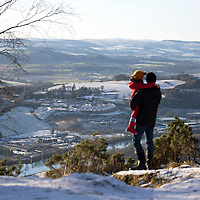 Snow and Ice, Perthshire...28.12.14<br /> A father and daughter take in the view of Perth from the top of Kinnoull Hill in Perth as the freezing conditions bite into another day..<br /> Picture by Graeme Hart.<br /> Copyright Perthshire Picture Agency<br /> Tel: 01738 623350  Mobile: 07990 594431