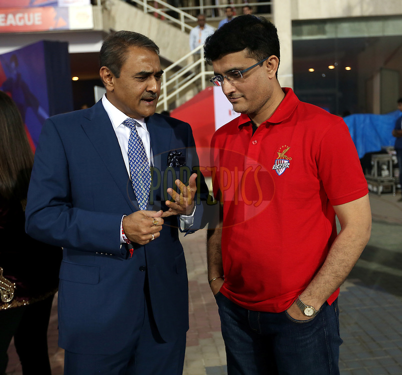 Praful Patel president of  All India Football Federation and Sourav Ganguly, Former India cricket player and co-owner of Atletico De Kolkata during the final of the Hero Indian Super League between Kerala Blasters FC and Atletico de Kolkata held at the D.Y. Patil Stadium, Navi Mumbai, India on the 2oth December 2014.<br /> <br /> Photo by:  Sandeep Shetty / ISL/ SPORTZPICS