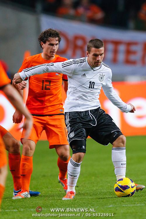 NLD/Amsterdam/20121114 - Vriendschappelijk duel Nederland - Duitsland, Daryl Janmaat in duel met lukas Podolski
