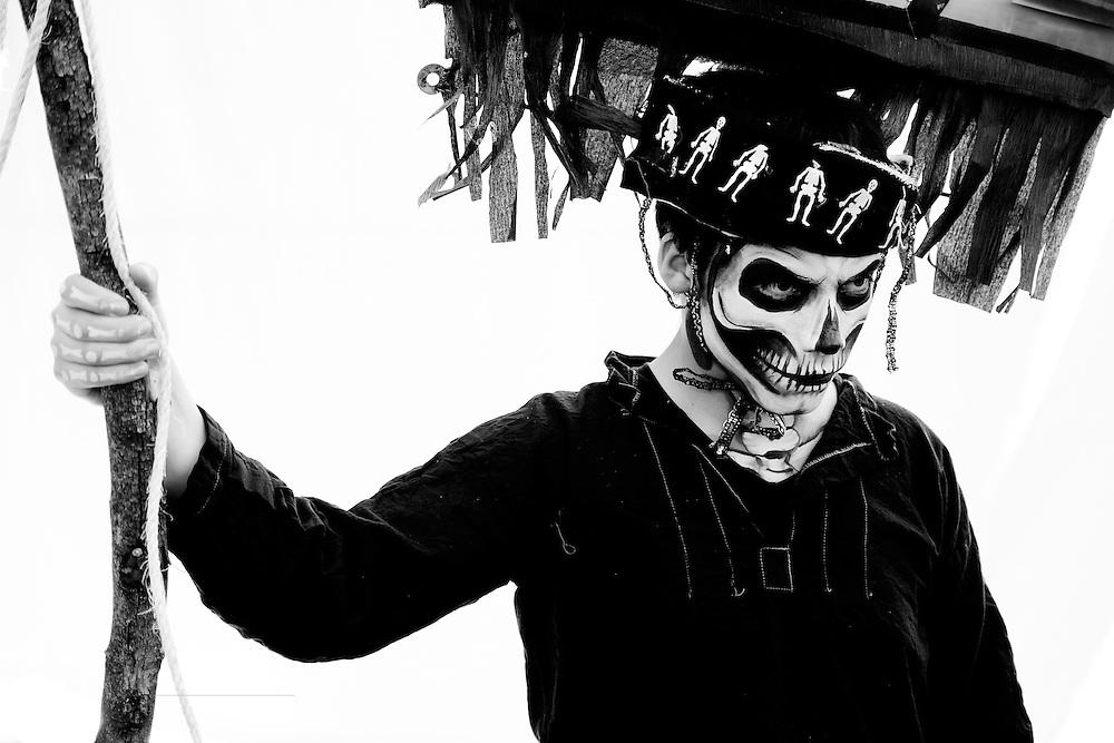 A young man participates in a Dia de los Muertos pageant