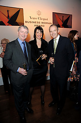 Left to right, STEPHEN QUINN, Carolyn McCall chief executive of the Guardian Media Group and GRAHAM BOYES at the presentation of the Veuve Clicquot Business Woman Award 2010 held at the Institute of Contemporary Arts, 12 Carlton House Terrace, London on 23rd March 2010.  The winner was Laura Tenison - Founder and Managing Director of JoJo Maman Bebe.