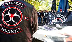 19.10.2014, Muenchen, GER, Aufmarsch von tuerkischen Nationalisten gegen die PKK, Der Rockerclub 'Turkos MC' rief zu einer Demonstration gegen die PKK auf. Laut Polizeiangaben hatte der Aufmarsch 200 Teilnehmer, weitere 50 Rocker fuhren auf Motorraedern vorneweg. Ein Grossteil der Teilnehmer trug Symboliken der nationalistischen 'Grauen Woelfe' und der MHP, viele zeigten immer wieder den sog. 'Wolfsgruss', im Bild Linsk ein Mitglied des MC in Lederkutte, rechts praesentieren andere Mitglieder ein Transparent des Clubs // during a parade by Turkish nationalists against the PKK. Rockers of 'Turcos MC' called for a demonstration against the PKK. According to police, the march had 200 participants, another 50 Rocker went on motorcycles in front. A majority of the participants wore symbolism of the nationalist 'Grey Wolves' and the MHP, many showed again the so-called 'Wolf greeting', Munich, Germany on 2014/10/19. EXPA Pictures © 2014, PhotoCredit: EXPA/ Eibner-Pressefoto/ Gehrling<br /> <br /> *****ATTENTION - OUT of GER*****