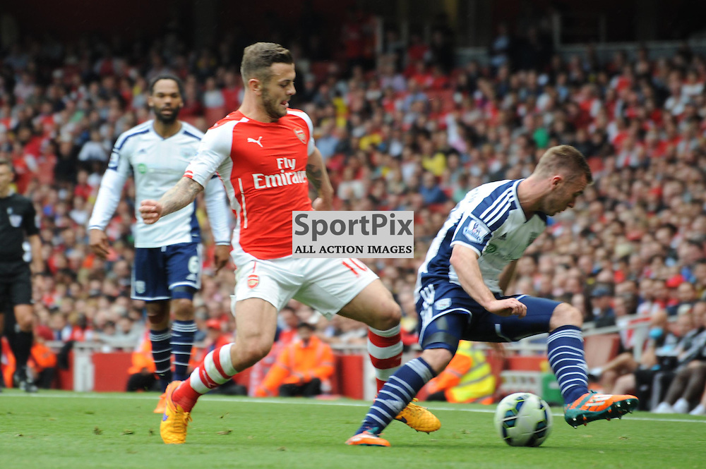 Arsenals Jack Wilshere and West Broms Callum McManaman in action during the Arsenal v West Brom match on Sunday 24th May 2015