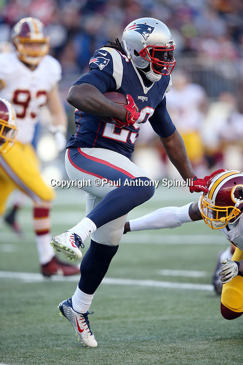 New England Patriots running back LeGarrette Blount (29) leaps while trying to avoid a tackle attempt as he runs for a third quarter gain of 21 yards and a first down at the Patriots 43 yard line during the 2015 week 9 regular season NFL football game against the Washington Redskins on Sunday, Nov. 8, 2015 in Foxborough, Mass. The Patriots won the game 27-10. (©Paul Anthony Spinelli)