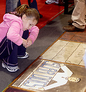 Madeline Groff, 7, from Oakwood, admires the work in the Slab Docs booth, during Miami Valley HomeWorld, at the Dayton Exposition Center in Vandalia, Saturday, February 10th.