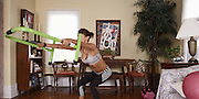 That's ONE way to do a squat thrust! Hilarious homemade workout video accidentally shows man using the toilet in the background<br /> <br /> The developer of a popular fitness site page dropped a massive photo bomb when he was caught using the toilet with the door open in the background of one of his company's home work out videos. <br /> As fitness model Lisa-Marie Zbozen demonstrates squat-lift exercises in a small apartment, Sean Light can be seen in the bathroom with the door open.<br /> Miss Zbozen doesn't seem to notice the other squat happening in the frame behind her, she simply goes about her business showing off the workout techniques. <br /> The video was posted May 9 on the site The DailyHiit, which specializes in devising videos of simple at-home workouts.<br /> It has garnered more than 165,000 views on YouTube - several times more than the average video posted on the site.<br /> <br /> The toned model acknowledged the hilarious blunder a few days later when she posted the video to her 195,000 followers on Facebook.<br /> 'This is me ... & there's Sean :D' she wrote, highlighting Mr Light in the background.<br /> <br /> The DailyHiit was founded by Frederick Light and his brother Sean as a way for a community of at-home fitness enthusiasts to shape up and tone their bodies. <br /> The site says it hopes to offer an alternative to expensive, awkward at-home workout machines by 'creating the very best fusion of workouts, community & inspiration for people all over the world every single day.'<br /> <br /> It features a small team of just four people, including single producer who edits the video.<br /> It's unclear how he missed the two camera angles that show Sean Light using the toilet. <br /> The site claims it has received more than 500million video views and more than 500,000 online followers.<br /> ©DailyHaiit/Exclusivepix