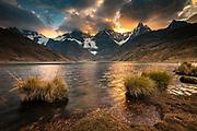 Carhuacocha lake, sunset on Siula Grande, Yerupaja and Jirishanca peaks, Andes mountains, Cordillera Huayhuash, northern Peru