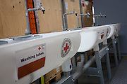Sanitation wash sinks in emergency supplies warehouse, Deutsches Rotes Kreuz (DRK - German Red Cross) at their logistics centre at Berlin-Schönefeld airport.