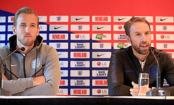 England manager Gareth Southgate (right) and Harry Kane during the press conference at The Grove Hotel, Hertfordshire.