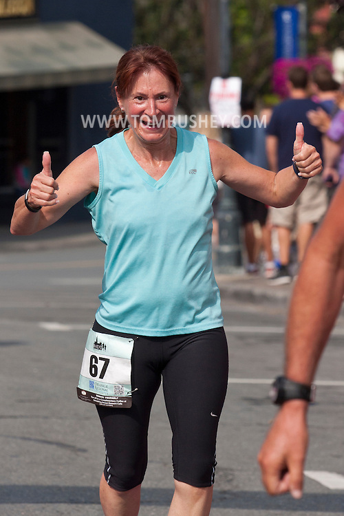 Middletown, New York - Runners compete in Orange Regional Medical Center's Run 4 Downtown road race on Aug. 16, 2014. All the proceeds from the Run 4 Downtown go to revitalizing Middletown's Historic district.