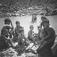 A group of young boys at a small river in Ha Giang province, Vietnam.