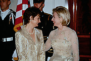 U.S. First Lady Hillary Clinton smiles as she chats with Cherie Blair, wife of British Prime Minister Tony Blair, in the receiving line at the State Dinner at the White House February 5, 1998 in Washington, DC.
