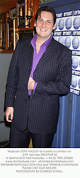 Musician TONY HADLEY at a party in London on 27th January 2003.PGR 52